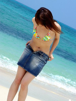 Cute asian teen babe Chikaho Ito stripping off her clothes outdoor