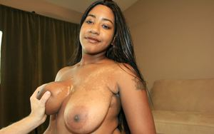 Lustful ebony babe gives a tugjob and gets a cumshot on her massive tits