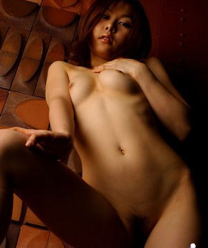 Svelte asian babe with tiny tits slipping off her white lingerie