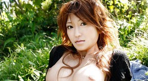 Sweet asian babe Yu Satome uncovering her petite tits outdoor