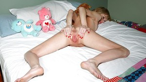 Flexy blonde babe with pigtails stripping and exposing her shaved cunt