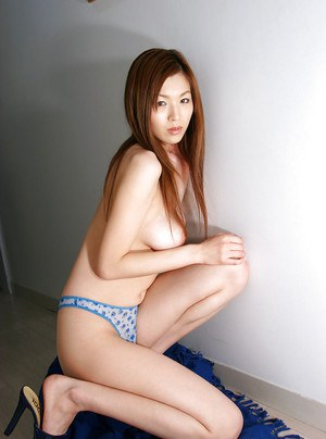 Graceful asian babe with sexy legs stripping off her dress and panties