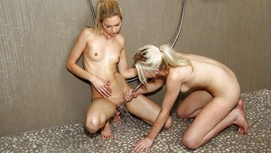 Slender amateur teen babes having some lesbian fun in the shower