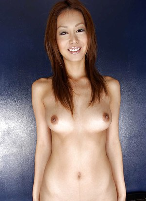 Alluring asian babe with amazing tits stripping off her clothes