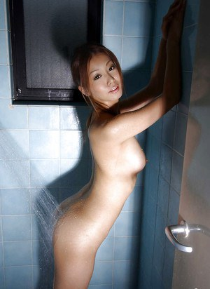 Pretty asian babe with sexy ass and perky tits taking a shower