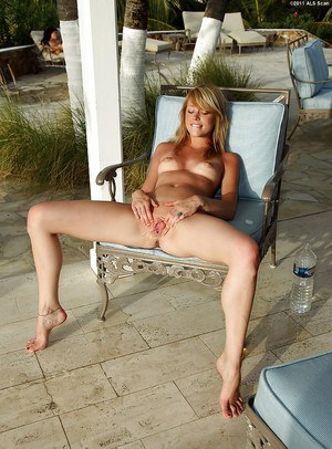 Svelte amateur blonde with perky tits teasing her cunt outdoor