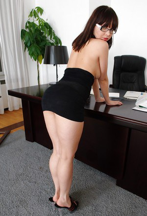 Brunette office hottie Lara Page uncovering her boobs and amazing fanny