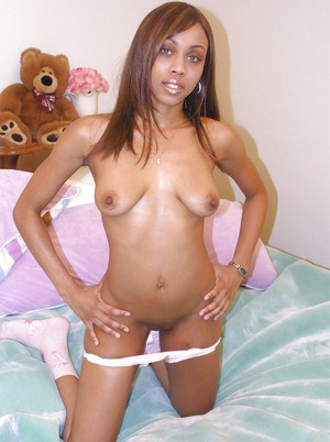 Sexy babe Ebony Green posing topless and taking off her panties
