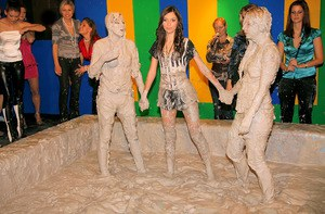 Stupendous fully clothed chicks are into messy mud wrestling