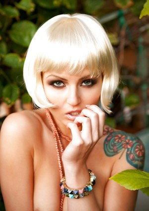 Lovely tattooed blonde babe Veronica LaVery posing naked outdoor