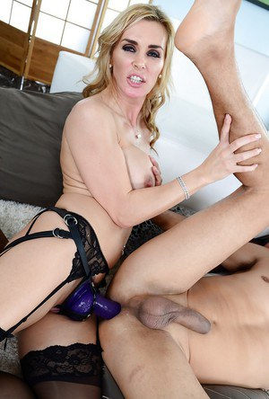 Big busted femdomes are into group strapon action with a horny guy
