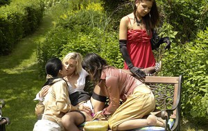 Lascivious fully clothed ladies having some lesbian fun outdoor