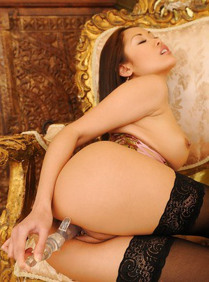 Filthy asian babe in black nylon stockings masturbating her tight slit