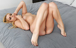 Foxy blonde babe Lexi Belle exposing her bare feet and stripping