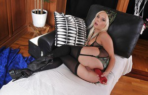 Filthy blonde vixen in nylon stockings playing with her anal toys