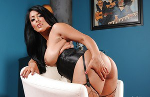 Hot latina babe Kiara Mia revealing her big jugs and trimmed pussy