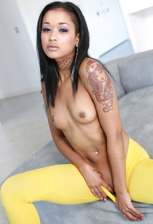 Slim ebony hottie with tiny tits Skin Diamond posing in yellow sneaks