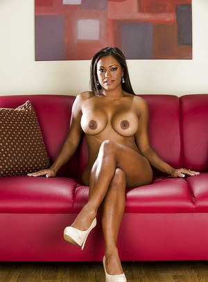 Full-bosomed ebony chick on high heels stripping off her clothes