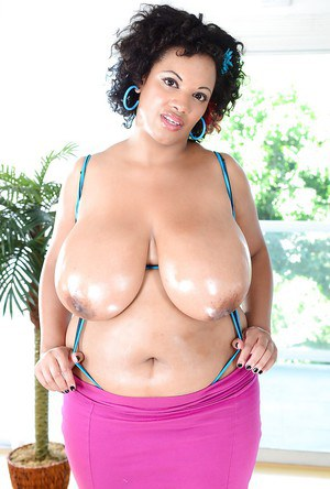 Buxom ebony lady with massive jugs Betty Blac stripping off her clothes