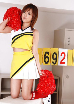 Loveable asian girl Caren Hasumi taking off her cheerleader uniform