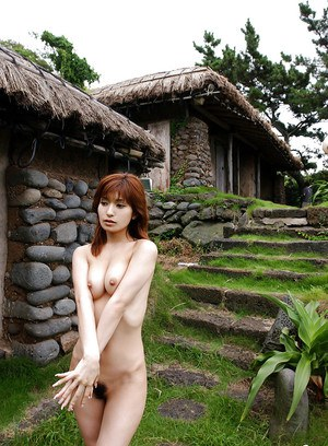 Petite asian chick with nice tits An Nanba posing naked outdoor
