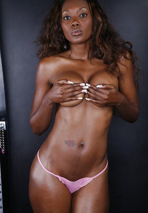 Seductive ebony chick Nyomi Banxxx slipping off her pink lingerie