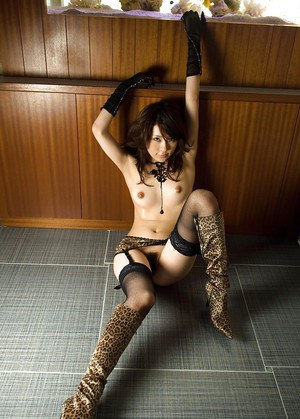 Arousing asian babe posing in nylon stockings and high heeled boots