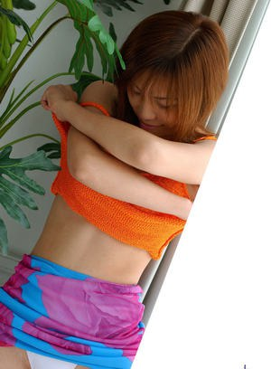 Fuckable asian gal with nice jugs stripping off her clothes
