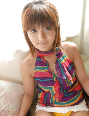 Alluring asian teen with lovely face uncovering her sexy body
