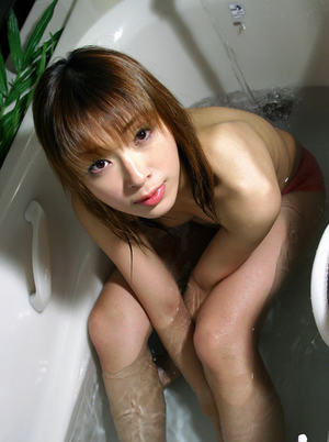 Alluring asian coed with tiny tits taking bath in her pink panties