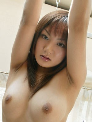 Sexy asian babe Noa Aoki uncovering her tits and taking off her shorts