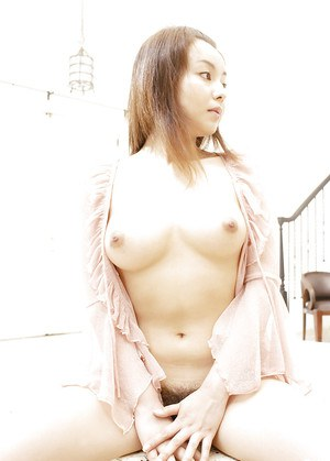 Seductive asian girl with hairy pussy Rio Kurusu posing barely clothed