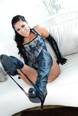 Busty asian gal London Keyes taking off her panties and slipping on a strapon