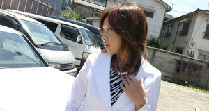 Fuckable asian chick in office suit uncovering her petite bosoms