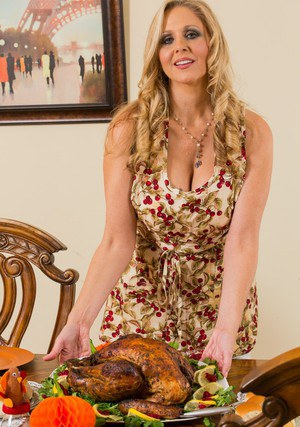 Tempting MILF with shaved cunt Julia Ann slipping off her dress and lingerie