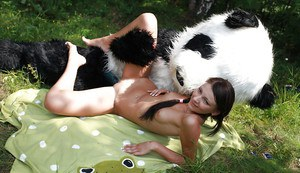 Naughty teen cutie with svelte body have some fun with a panda toy outdoor