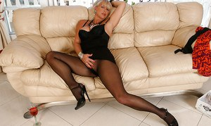 Stupendous mature blonde in pantyhose revealing her gorgeous big tits