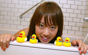 Cute Asian babe Kanami taking a shower in her one piece bathing suit