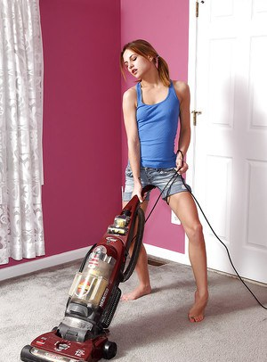 Saucy teenage hottie getting horny and playing with a hoover