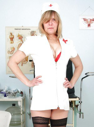 Raunchy mature lady in nurse uniform and stockings revealing her twat