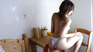 Tempting asian coed with unshaven muff stripping off her clothes