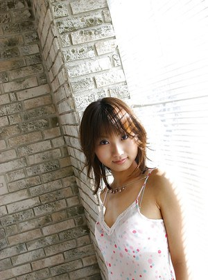Pretty asian teen on high heels stripping off her lingerie