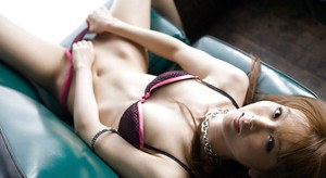 Asian cutie Rika Sakurai slipping off her lingerie and spreading her legs