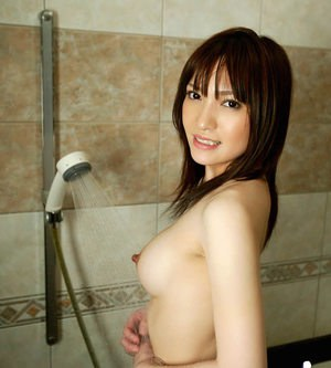 Bosomy asian babe takes a shower and gets fucked hardcore