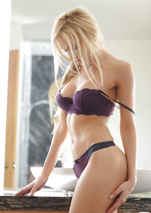 Graceful blonde hottie with amazing ass Jennifer Vaughn posing in lingerie