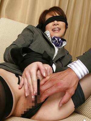 Blindfolded asian lady in stockings gets her pussy stuffed with sex toys