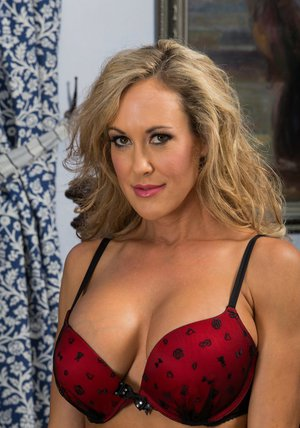 Busty minx in stockings Brandi Love stripping off her lingerie