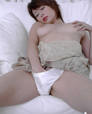 Barely clothed asian babe Nana Natsume teasing her hairy pussy