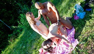 Sweet coeds get their fannies glazed with cum after a threesome outdoor