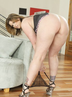 Buxom MILF on high heels Lisa Sparxxx reveals her big tits and shaved cunt